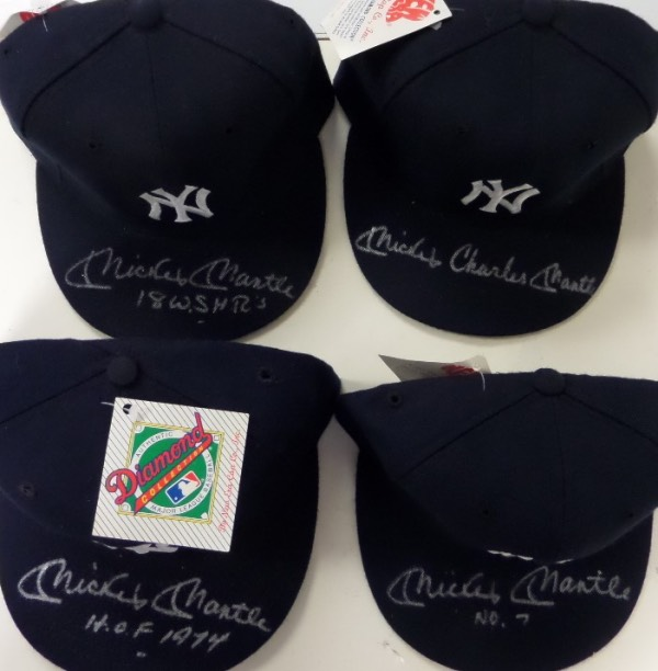 This fantastic collector's/dealer's chance is FOUR fitted NY Yankees caps from New Era, each in MINT condition with original tagging still attached.  Each is hand-signed brightly in silver on the top of the bill by Yankees legend, Mickey Mantle, each grading an 8 or better, and each has a different inscription, including No. 7, HOF 1974, 18 WS Home Runs, and Mickey Charles Mantle!  WOW!  Awesome lot, and with each cap valued into the mid hundreds on the retail circuit, retail potential here is staggering!