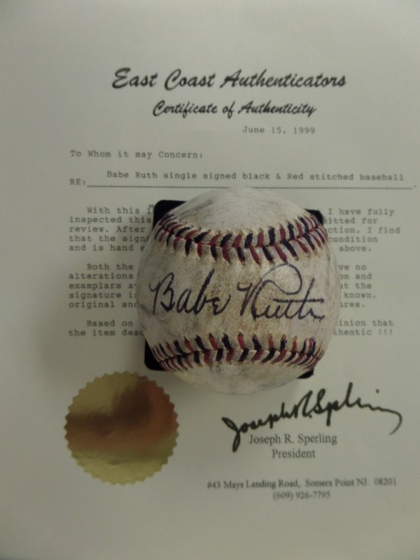 This very old red and black-laced baseball is unlabeled, and comes to us in G/G+ overall condition.  It features the black ink signature of Babe Ruth right across the sweet spot, grading a solid 7.5 overall, and comes with a full LOA from East Coast Authenticators for certainty.  A real gem of a display item, ideal for any baseball collection, and retail is FIVE FIGURES!