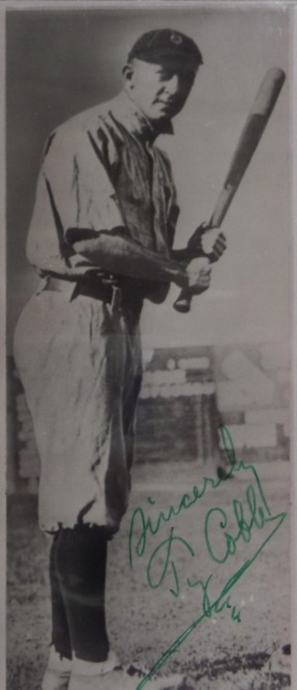 This very old black and white wire photo shows the date of July 16, 1951 on the back in a red stamp, and is an image of Ty Cobb in a batting stance on the front.  It comes hand-signed in his standard green ink, with Sincerely added, and grade is a legible 7 overall.  Retail is easily low thousands on this beauty!