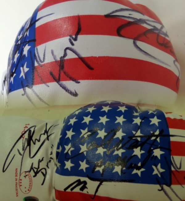 This MINT USA flag 14 ounce boxing glove is ideal for display and comes signed in black by 5 stars from the first 4 ROCKY movies!! GORGEOUS signatures and included are SYLVESTER STALLONE, CARL WEATHERS, MR. T, HULK HOGAN, & DOLPH LUNDGREN.  A few have even included their character names in the movies! Great boxing collectible and high retail.