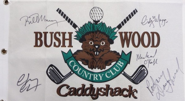 "This white CANVAS ""Bushwood Country Club"" pin flag from the movie Caddyshack has been black felt marker signed by 5 cast members, including Michael O'Keefe, Cindy Morgan, Chevy Chase, Bill Murray, and the late Rodney Dangerfield.  All signatures grade 8's and above on this piece that is a must have for fans of the classic comedy, and values into the hundreds!"