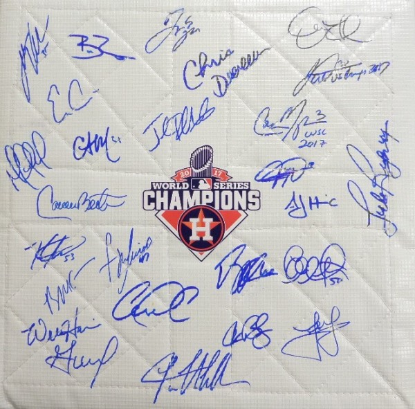 This white bag style base measures a square 14x14, and is in store-bought condition, with straps still attached.  It features a 2017 Houston Astros World Series Champions logo in the center, and comes hand-signed all around in blue sharpie by manager AJ Hinch and 25 of his champs!  Included are Justin Verlander, Jose Altuve, Carlos Correa, Dallas Keuchel, Carlos Beltran, Brian McCann, George Springer, Charlie Morton, Alex Bregman, Lance McCullers, and more.  A fabulous collector's item and a MUST for Astros fans to commemorate their team's very first title!