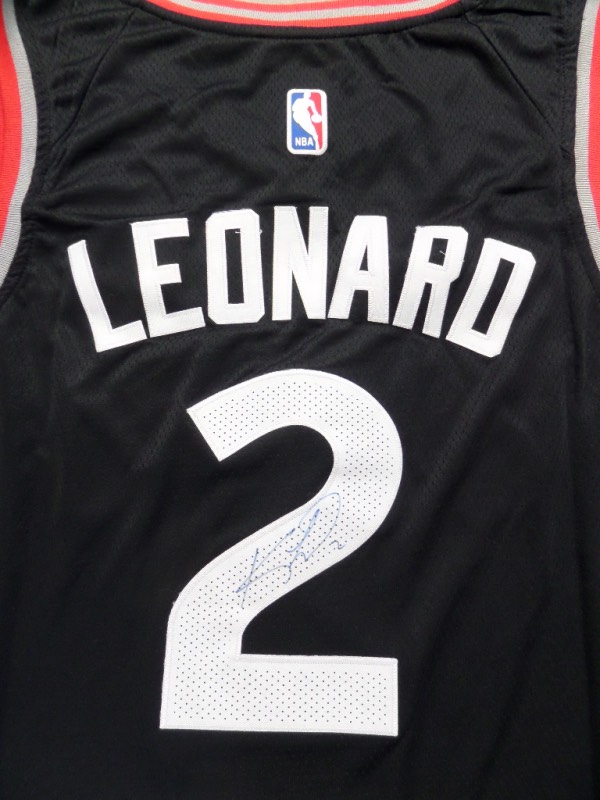 This authentic-style beauty is black and mint! It is trimmed in red & white and comes signed on the back number in blue sharpie by this future HOFer and current best overall player in the game. He has included his #2 and it shows off superbly. NICE from this recent NBA Champ and MVP