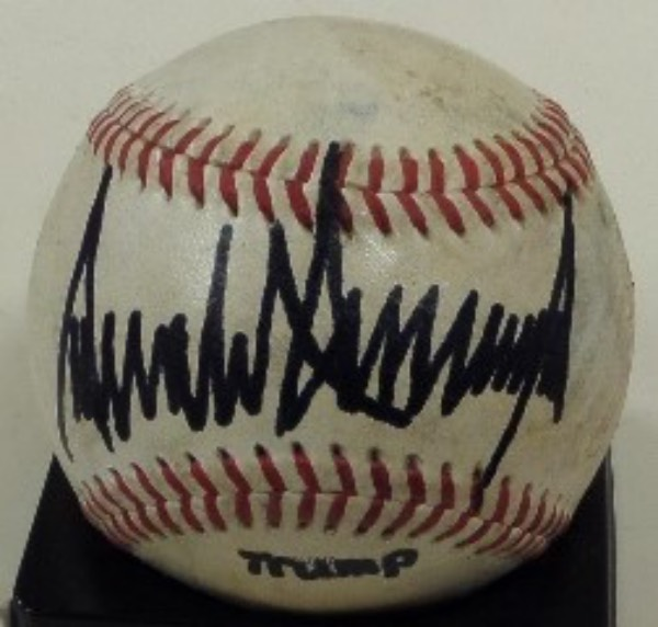 This Official Major League Baseball from Rawlings is in VG condition, and comes sweet spot-signed in black sharpie by the President of the United States, Donald Trump.  Signature grades a bold 9 overall, and with his Presidency now assured, retail here is high hundreds!