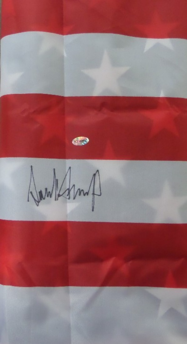 This whopping approx. 4'x3' mint USA flag comes signed on an ideal spot by President Trump in thin black sharpie! Ideal for framing or hanging by eyelets and showing off and comes hologrammed and guaranteed authentic for authenticity purposes. Retails in the high hundreds++.