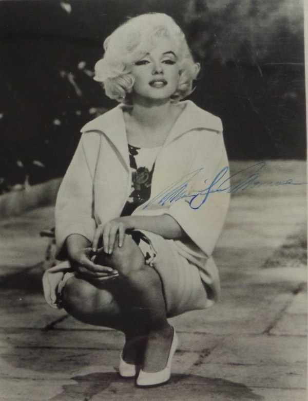 This black and white 8x10 photo shows a more mature Marilyn, probably in the late 1950's, and is in EX overall condition.  It is hand-signed in blue by the icon of icons herself, and though the signature has faded a bit over the years, it still grades an overall 5, and with Monroe's death now more than a half century ago, retail on this frame-ready 8x10 is low thousands!