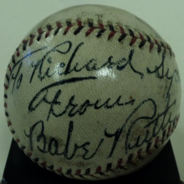 "This Spalding OAL ball has multi-colored laces and a light shellac on it.  It is in VG shape overall and comes signed over the left side of the stamping by the Babe!! The signatures is in bold black ink and he has included ""To Richard Sydney From"" above his autograph!! Amazing piece of history from the best ever and BV into the 5 figures easily."