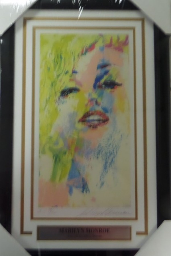 This Hollywood stunner is a custom triple matted and wood framed display, measures near 14x24 in size, and holds a numbered Artists Proof of Marilyn from famed artist LeRoy Neiman. It comes hand signed by the famous, deceased painter, value is many times our asking price, and show off is easy from 20+ feet away. Loaded with color and style, and an easy buy and hold art world investment.