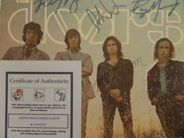 "This original 1968 ""Waiting For the Sun"" LP album from The Doorsis still in EX condition overall, and comes hand-signed by all four HOF band members.  Included are Ray, Robbie and John, all in a dark blue marker, and Jim in black ink, and the album comes with a photo COA from ROC Memorabilia for certainty.  With half of the band now deceased, retail on this baby is low thousands!"