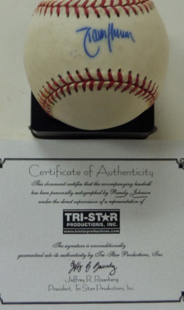 This Official Major League Baseball from Rawlings is in VG+ condition, and comes hand-signed across the sweet spot in blue ink by HOF lefty flamethrower, Randy Johnson.  Signature grades about a 7.5, and the ball includes a COA from TRISTAR Productions for rock solid authenticity!