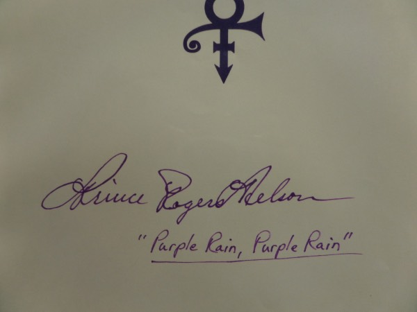 "This full page letterhead measures 8.5x11 with the Prince ""symbol"" at the top in deep purple.  It comes hand-signed in purple, ready Prince Rogers Nelson, and includes a ""Purple Rain, Purple Rain"" inscription.  Grades a nearly perfect 9 all over, and is ideal for framing and display!"