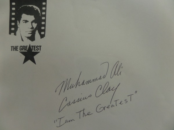 "This 8.5x11 full page of light gray paper features a ""The Greatest"" letterhead at the top left hand corner, and is hand-signed in black ink by the man himself.  The signature grades a legible 8, reading Muhammad Ali, Cassius Clay, and ""I am the Greatest,"" all in his hand.  Perfect for framing and display, and value has shot up since his death!"