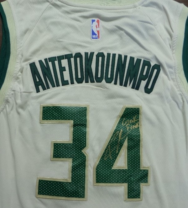This mint creme & green Milwaukee Bucks authentic-style jersey comes signed on the back by last years finalist and superstar in gold with GREEK FREAK included by Giannis! Obtained in person by my consignor and guaranteed authentic and retails in the mid hundreds and quickly rising!