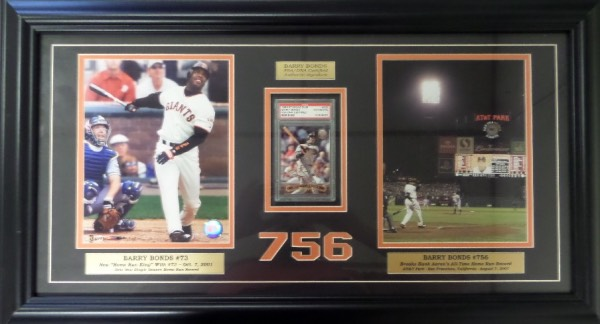 "This piece is stunning and measures approx. 34""x20"" after custom matting and framing in black!  It honors HR #756 and comes with color 8x10's, placards, and a signed and PSA/DNA slabbed and certified 1996 SC #402 bb card! Comes with a Stacks of Plaques COA as well and when first produced when he broke the record the retail was over $1,000."