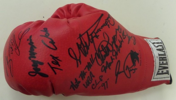 This red slip on style boxing glove from Everlast is in NM condition, and comes hand-signed in bold black sharpie by 10 greats of the ring.  Included are 3 time champion Terry Norris, HOF great Aaron Pryor (dec), HOF'er Joey Maxim (dec), 3 time champ Bobby Czyz, former champ Nate Miller, Tex Cobb and four others--please see our attached photo.  Awesome piece, personally obtained during a HOF Induction ceremony, and with the deceased HOF'ers present, retail is well up into the hundreds!