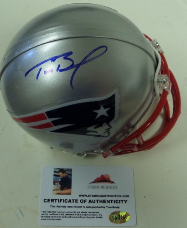 This New England Patriots mini football helmet from Riddell is still in EX+ condition, and comes hand-signed in blue sharpie by their 4 time Super Bowl MVP QB, Tom Brady.  Signature grades a legible 7.5-8, and the helmet includes a photo card COA and hologram from Stadium Authentics for rock solid authenticity.  Valued well into the hundreds!