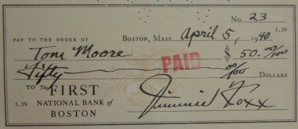 This 2.75x6.25 personal check from the National Bank of Boston is dated April 5, 1940, and comes hand-signed at the bottom by A's HOF great, Jimmie Foxx.  Signature is a strong 8 at least, and the check is endorsed on the back by the person--Tom Moore--to whom it was made out to.  Fantastic item here, ideal for matting and framing with the photo of your choice, and retail is low thousands, to be sure!