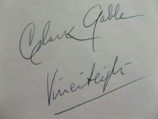 "This vintage white, unlined cut measures approximately 4x6"" and is in EX+ condition.  It is blue fountain pen ink-signed by the costars of the 1939 Academy Award winning classic, ""Gone With The Wind"".  Included are Clark Gable on the top and Vivien Leigh on the bottom, each signature grading a strong, legible 7-7.5 at least.  A great looking piece that will frame and mat with the photo or movie poster of your choice for a simply astounding display.  Valued well, well into the hundreds!"