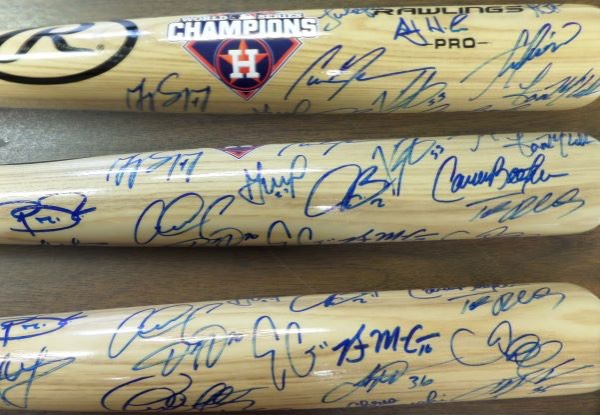 This blonde Rawlings baseball bat is in MINT condition, with a Houston Astros 2017 World Series Champions logo on the barrel.  It is barrel-signed by more than 20 members of that WS Championship squad, including AJ Hinch, Jose Altuve, Carlos Beltran, Brian McCann, Justin Verlander, George Springer, Alex Bregman, Dallas Keuchel, and many more.  A MUST for any Astros collection, and a true memento from the team's first ever World Championship!