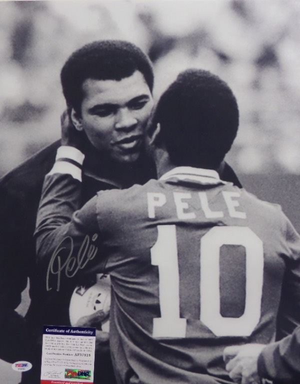 This HUGE black and white 16x20 photo shows soccer legend, Pele, embracing three time Heavyweight Champion, Muhammad Ali.  It is beautifully-penned in silver by the all time pitch great himself, and comes fully PSA/DNA certified (AF37818) for authenticity purposes.  A gorgeous display photo, ideal size for framing, and retail is well into the hundreds!