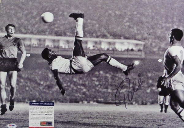 This large black and white 16x20 photo shows soccer legend Pele in a mid air bicycle kick.  It is hand-signed boldly in black sharpie by the all time great himself, grading a strong 9 overall, and comes certified by PSA/DNA (AF21794) for authenticity purposes.  A MUST for any soccer collection, and valued well into the hundreds!