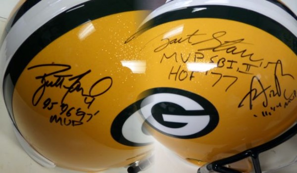 This mint full-sized Riddell  stunner is loaded with green, gold and white team colors, comes from Riddell, and is a beauty. It comes black sharpie signed by only 3, but all are HOF caliber, or already Inducted Greats. Signers are Bart Starr, Brett Favre and Aaron Rodgers, and grade all over is a clean bold 10. Solid NFL/HOF buy and hold investment, and value is well into the low thousands with AWESOME descriptions added and the recent death of Starr.