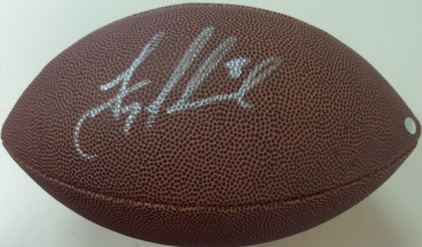 This NM Wilson NFL football is a real looker, and comes hand-signed in silver by Cowboys HOF quarterback and all time great, Troy Aikman.  Signature grades about a 7.5 overall, and the ball is affixed with a hologram from Mounted Memories for authenticity purposes.  A perfect fit for any Cowboys collection, and retail is high hundreds!