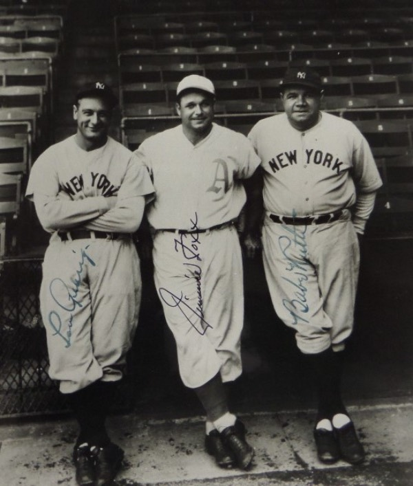 This fantastic and RARE 8x10 is a black and white image of three of baseball's all time greatest players EVER, all posing for the camera in the early 1930's.  It is hand-signed in fountain pen ink by all three, with Yankees HOF legends Babe Ruth and Lou Gehrig in blue, and A's HOF great Jimmie Foxx in black.  A stunning photo that will frame and display proudly in any collection, and retail on this beauty is well, WELL into the thousands!