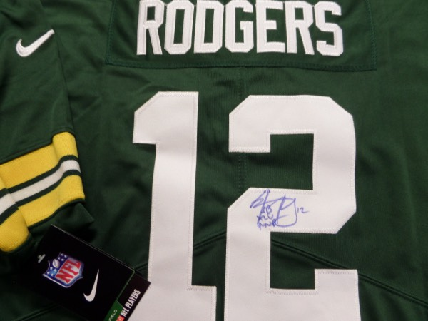This green size XL custom Green Bay Packers #12 Rodgers jersey is in MINT condition, and comes trimmed in yellow and white, with everything hand-sewn.  It is back number-signed in blue sharpie by the All Pro passer himself, complete with his #12 and a SB XLV MVP inscription, and will frame and display beautifully for any football collection.  Valued well into the high hundreds+++.