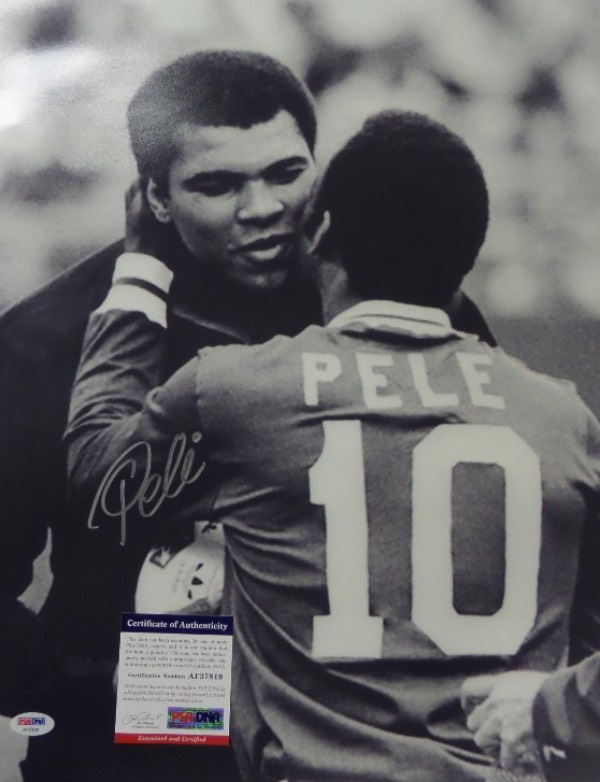 This HUGE black and white 16x20 photo shows soccer legend, Pele, embracing three time Heavyweight Champion, Muhammad Ali.  It is beautifully-penned in silver by the all time pitch great himself, and comes fully PSA/DNA certified (AF37819) for authenticity purposes.  A gorgeous display photo, ideal size for framing, and retail is well into the hundreds!