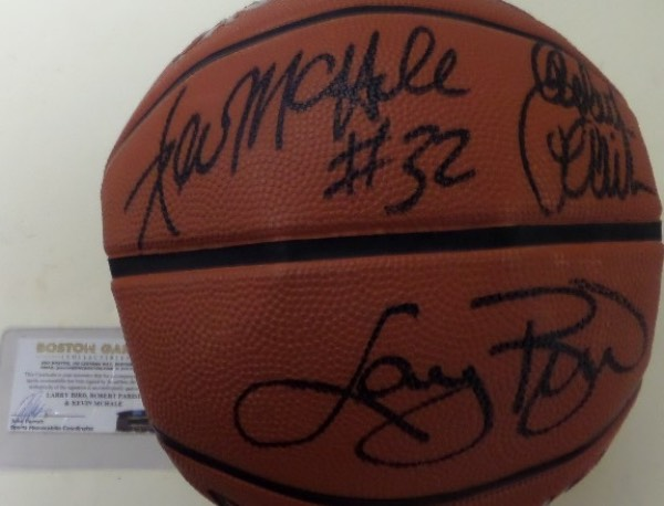 This full size basketball from Spalding is in EX/MT shape and not fully inflated.  It comes hand-signed by the frontcourt trio that led the Boston Celtics to 3 titles in the 1980's, and each is enshrined in the NBA Hall of Fame.  Included are Larry Bird, Kevin McHale and Robert Parish, all in black, and the signatures reside on two adjacent panels for optimal display value.  Retail here is high hundreds on this MUST HAVE Celtics piece that comes with a COA from Boston Garden Collectibles to boot!