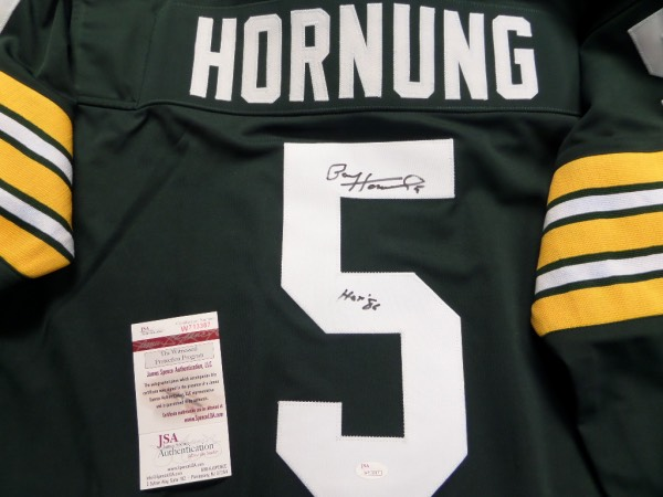 "This absolute beauty is a custom XL green Green Bay Packers jersey in NM/MT condition, with everything hand-sewn.  It is back number-signed in black sharpie by the ""Golden Boy"" 'himself, Packers HOF back/kicker, Paul Hornung, grading a legible 8, with 5 and HOF '86 inscriptions added, and the jersey comes fully ""JSA"" certified (W713387) for authenticity purposes.  Valued into the high hundreds!"