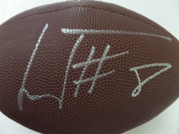 This mint official NFL ball comes signed superbly in silver by this favorite for MVP and young Ravens star QB!  He has included his #8 with the signature and it is guaranteed authentic and retail is shooting up!!! Nice.