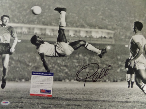 This large black and white 16x20 photo shows soccer legend Pele in a mid air bicycle kick.  It is hand-signed boldly in black sharpie by the all time great himself, grading a strong 8 overall, and comes certified by PSA/DNA (AF37831) for authenticity purposes.  A MUST for any soccer collection, and valued well into the hundreds!