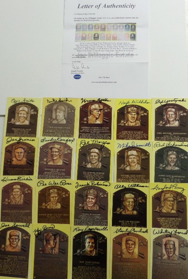 This fantastic HOF grouping is TWENTY different gold plaque postcards, each hand-signed by the diamond dandy pictured.  Included are Yaz, Wilhelm, Spahn, Snider, O. Smith, Schoendienst, Schmidt, Morgan, Koufax, Cronin, Perry, B. Williams, F. Robinson, Reese, Killebrew, Ford, Coveleski, Campanella, Berra and Sewell, and a full photo LOA is included from the Joe DiMMaggio Estate for authenticity purposes.  With 11 of the 20 now deceased, retail on this bunch is easily low thousands, so get in on our paltry minimum bid!
