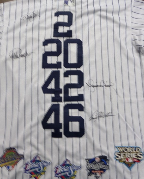 "This amazing, specially made Majestic jersey has the sewn on ""NY"" logo on front, and 4 different uniform numbers, AND 5-World Series patches on the back. It is a custom make, comes black sharpie, hand signed by Posada, Rivera, Pettitte and Jeter, and value is 3 grand all day long. Solid MLB and future HOF buy and hold piece and investment, and sold here at or above this starting bid price."