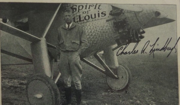 "This relic is almost 100 years old and in fabulous condition overall. It shows the famed flyer posing, next to an airplane, and his famous ""Spirit of St. Louis"" flyer. It is about 3.5x5.5 in size, looks to be a Kodak type of photo postcard, and comes black ink signed by the Great American Hero across the top. The signature is an 8, and retail is high hundreds!"