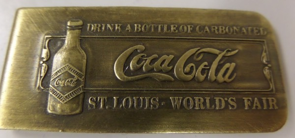 "This SOLID Brass money Clip from the 1904 Worlds Fair in St Louis is in Great condition, and is 2¼ x 1"" in size. This has the COCA COLA Bottle on the front with the COCA COLA in script, along with (Drink a bottle of Carbonated"" and then COCA COLA underneath., and St. Louis Worlds Fair under that. On the back it has ""Tiffany Studios St Louis Worlds Fair 1904 Patent Pending"". What a Valuable collectible this piece is and perfect for Coca Cola or World's Fair collectors"