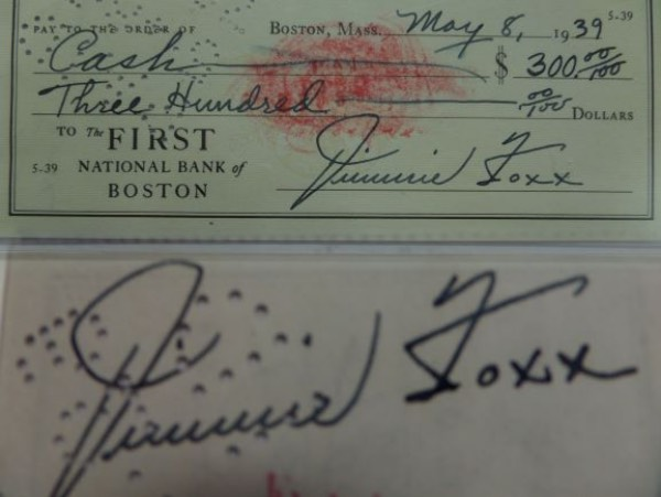 "This classic Foxx collectible is one of his very OWN personal business checks, and comes boldly signed on the front and back. TWO high value HOF signatures for one bid here, and it comes dated from 1939 on the ""First Bank of Boston"". Great piece, could be matted and framed specially with both signatures showing, and value is thousands!!! Some cancellation marks do go through the back signature, but only on his first name."