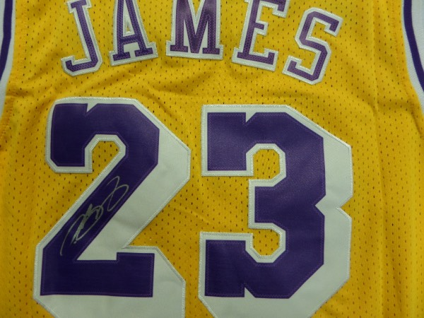 This tagged right game jersey even has the 2 inches of extra length tag in the waist and is the attractive home gold style, trimmed in white and purple team colors, and complete with sewn on everything. It is a gem from the future 1st ballot HOF Great, comes back #23 signed in silver, and value might be over a grand on the toughie.