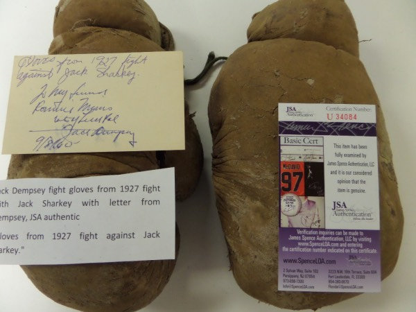 This item is amazing and belongs not at my desk, but in the boxing Hall of Fame for exhibit. It is a super well used pair of vintage boxing gloves. They were worn by Dempsey in his famous 1927 Jack Sharkey fight, and a hand signed and written note from Jack Dempsey, dated from 1960 accompanies,. A Jimmy Spence lifetime, numbered COA comes with for provenance, and value is thousands-maybe TENS of thousands!!!
