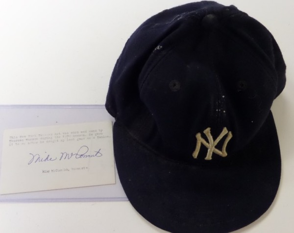 This top tier Yankee item was used by Munson in 1970 and is a New Era old school Pro-Model, and fitted. It shows a lot of usage, is shrunk a bit from time and rain wear, and has his #15 written in the sweat band. It comes with a hand signed PSA approved/hologrammed note from teamate and pitcher Mike McCormick who gives the story of the acquisition from Munson. It is a remarkable item, value has to be thousands, and we don;t expect to EVER see another one.