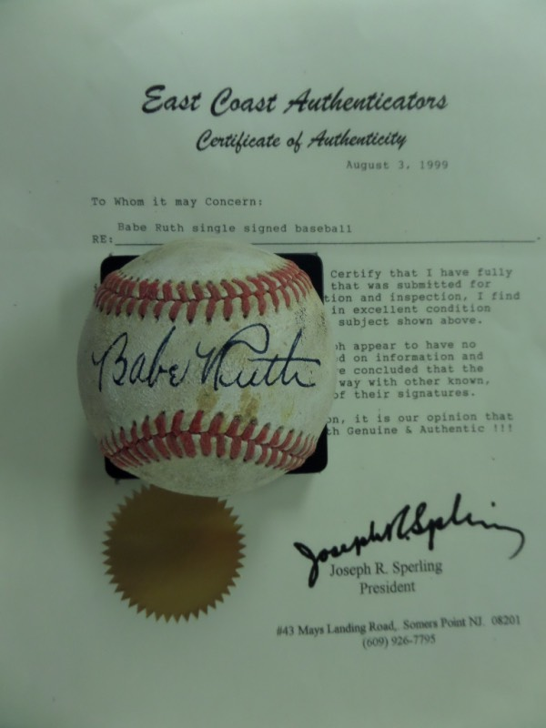 This red-laced vintage baseball is in G+ overall condition with considerable age evident.  It features the sweet spot signature of Babe Ruth in black fountain pen ink, the autograph fading evenly with the ball and grading about a 6-6.5 overall.  Comes with a full LOA from East Coast Authenticators for your assurance, and book value here is $10,000!