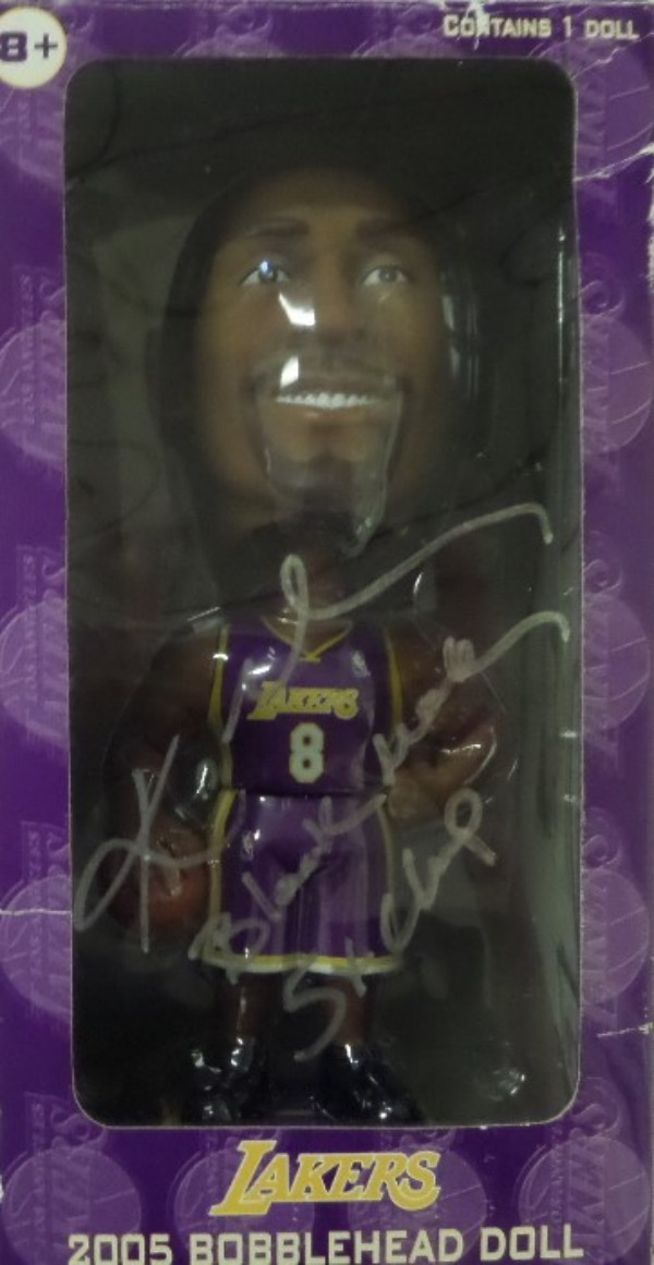 "This vintage bobblehead comes in the original box, dated from 2005 by both Upper Deck and Carl's Jr., and comes front side signed in silver by the just deceased megastar. It reads ""5X Champ & Black Mamba"", value is priceless since his crash, and we can guarantee authenticity forever. The box itself is fine+, and obviously value is HUGE!!!"