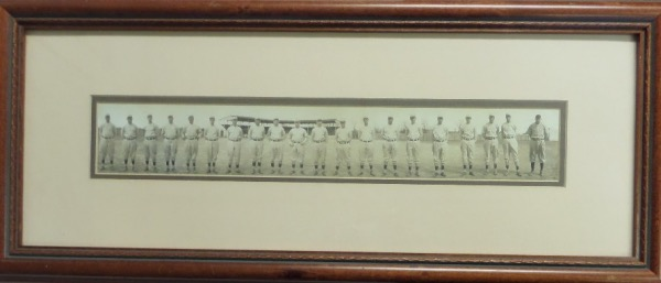 This impossible attic find is a high quality piece, a real B&W vintage team image, and done in panoramic style. It shows everyone posing, in full uniforms, and while they look you straight in the eye! It comes custom double matted, professionally wood framed, and shows off EZ from across my auction room. Condition is superb, and value is sky high on a piece your never gonna see again!