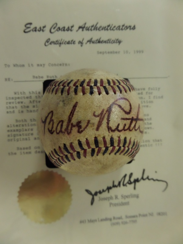 This red and black-laced vintage baseball is in VG overall condition with considerable age evident.  It features the sweet spot signature of Babe Ruth in dark red fountain pen ink, the autograph fading evenly with the ball and grading about a 7 overall.  Comes with a full LOA from East Coast Authenticators for your assurance, and book value here is $10,000!