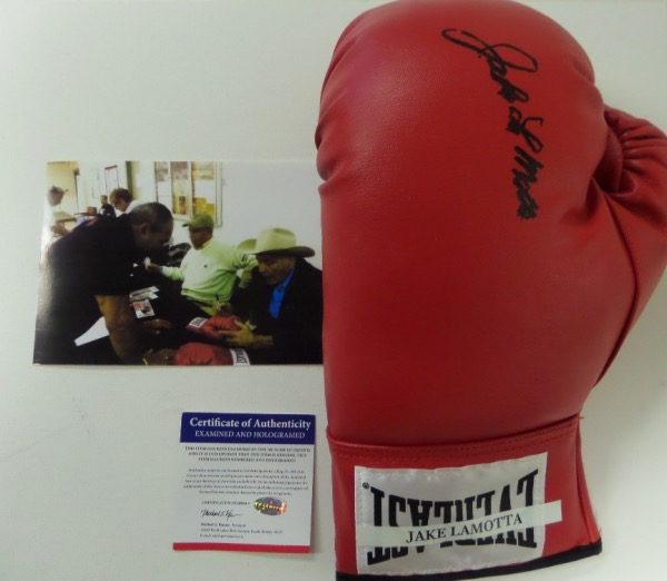 This beautiful MINT red lace up boxing glove from Everlast is hand-signed in black sharpie by the Bronx Bull himself, Middleweight Champion of the World and HOF great, Jake LaMotta!  The signature grades about a 7 overall, and the glove comes with a COA and a photo from the in person signing for authenticity purposes.  Valued well into the hundreds with LaMotta no longer living!
