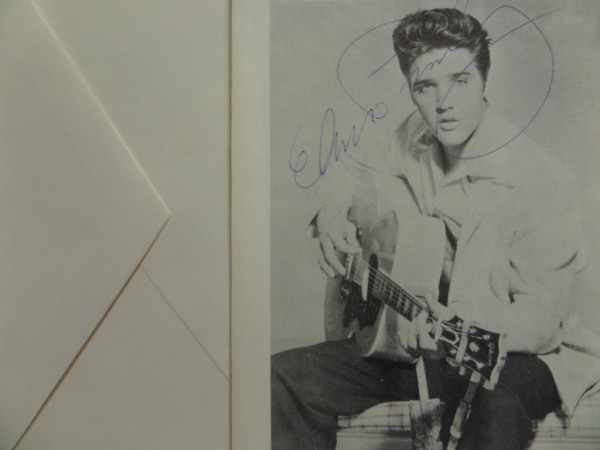 "This approx. 4.5""x5.5"" blank-back photo-postcard is from the 70's and shows a very young Elvis on it.  It has been signed in blue ink superbly and in full name style by Elvis and comes with the original envelope it goes in.  Perfect for matting/framing and high retail. Guaranteed authentic."