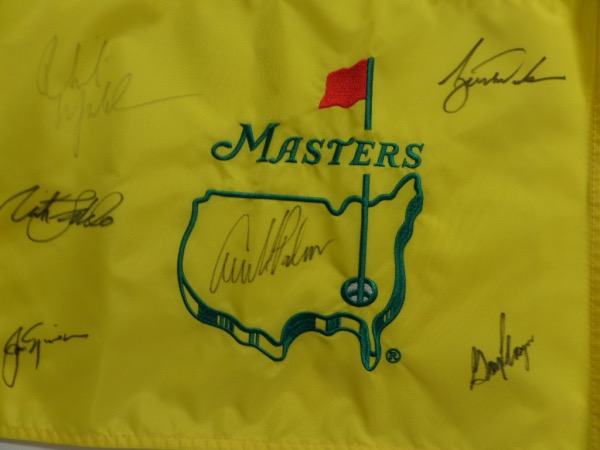 This mint & embroidered gold flag is NICE and comes signed by 6 three-time or more winners in black!! Included are ARNOLD PALMER, JACK NICKLAUS, TIGER WOODS, PHIL MICKELSON, NICK FALDO, & GARY PLAYER!  Ideal for the golf fan to display proudly.