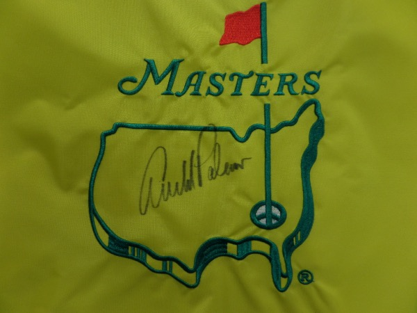 This mint, gold MASTERS pin flag is embroidered and has eyelets for hanging and display. It comes signed in the center by this deceased legend superbly in black sharpie. Guaranteed authentic and retails in the high hundreds.